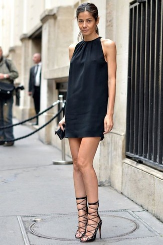 Glam up for the day in a black silk shift dress. For the maximum chicness choose a pair of black studded suede heeled sandals. Bet you could rock a version of this getup all season long.