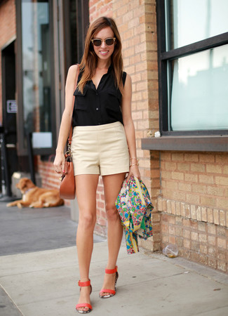 Opt for a black sleeveless button down shirt and beige shorts for a standout ensemble. And if you want to instantly bump up the style of your look with one piece, enter orange leather heeled sandals into the equation. Ideal for summertime, this getup will gain quite a few likes on the 'gram too.