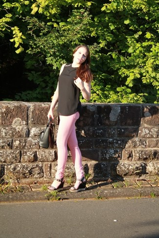 Who said you can't make a style statement with a casual outfit? You can do so with ease in a black silk shell top and rose pink skinny jeans. This look is complemented perfectly with black studded leather wedge sandals. As this combination clearly shows, you can't think of a better option for hot weather.