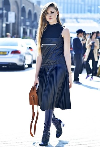 How to wear: black sleeveless turtleneck, black leather overall dress, navy leather knee high boots, brown leather tote bag