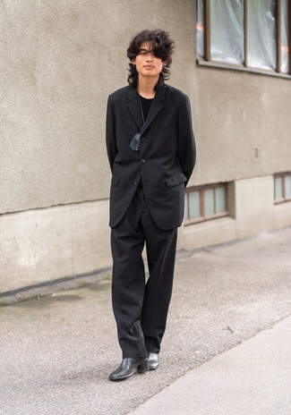 Black Suit Outfits: Marry a black suit with a black crew-neck t-shirt and be prepared to get the status of a true connoisseur of modern men's fashion. For something more on the sophisticated end to finish this outfit, complement this ensemble with black leather chelsea boots.