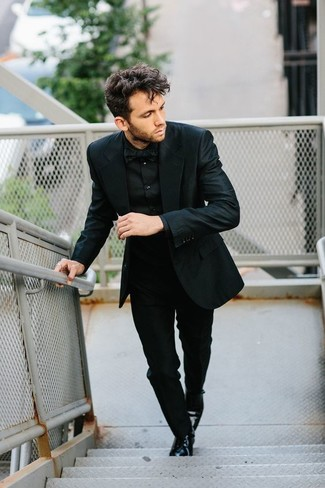 How to Wear a Black Bow-tie For Men: If you prefer off-duty combos, then you'll appreciate this pairing of a black suit and a black bow-tie. To give your overall ensemble a more elegant feel, why not add a pair of black leather derby shoes to the mix?