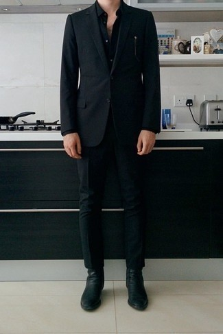 How to Wear a Black Dress Shirt For Men: This combination of a black dress shirt and a black suit is a real life saver when you need to look polished and really stylish. In the shoe department, go for something on the casual end of the spectrum and round off your look with a pair of black leather chelsea boots.