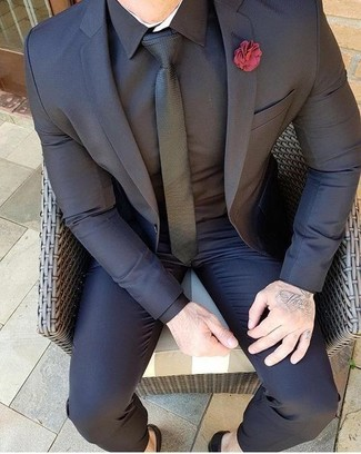 How to wear: black suit, black dress shirt, black tie, red lapel pin