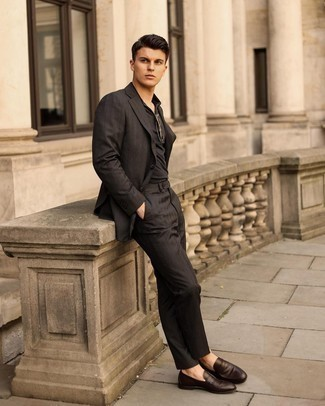 Dark Brown Leather Loafers Outfits For Men: Parade your menswear game by pairing a black suit and a black polo. Why not introduce a pair of dark brown leather loafers to this look for an added touch of class?