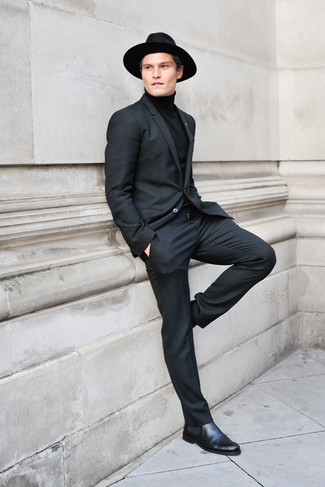 Wear a turtleneck with a black turtleneck for a sharp classy look. Round off this look with black leather chelsea boots.