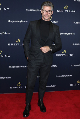 How to Wear Black Leather Dress Boots For Men: You're looking at the solid proof that a black suit and a black turtleneck are amazing when paired together in a classy outfit for today's gentleman. Up the ante of your getup by slipping into a pair of black leather dress boots.