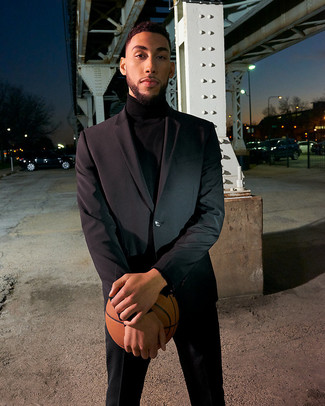 How to Wear a Black Turtleneck For Men: Reach for a black turtleneck and a black suit for classy style with a modern spin.