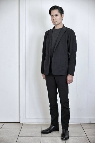 Black Suit Outfits: Pair a black suit with a charcoal crew-neck t-shirt if you're going for a sleek, dapper ensemble. Up your outfit by slipping into a pair of black leather chelsea boots.