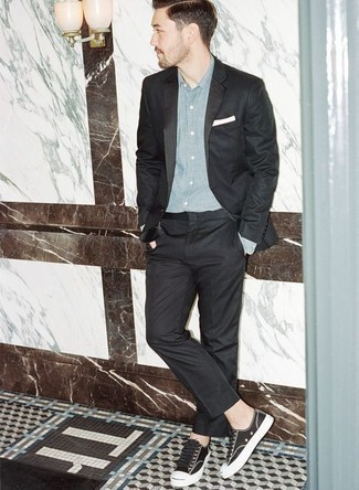 Black Suit with Low Top Sneakers Outfits: A black suit and a light blue chambray dress shirt are robust players in any man's collection. Infuse a dose of stylish nonchalance into this outfit by rocking low top sneakers.