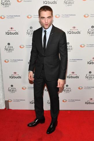 How to wear: black suit, light blue dress shirt, black leather derby shoes, black silk tie