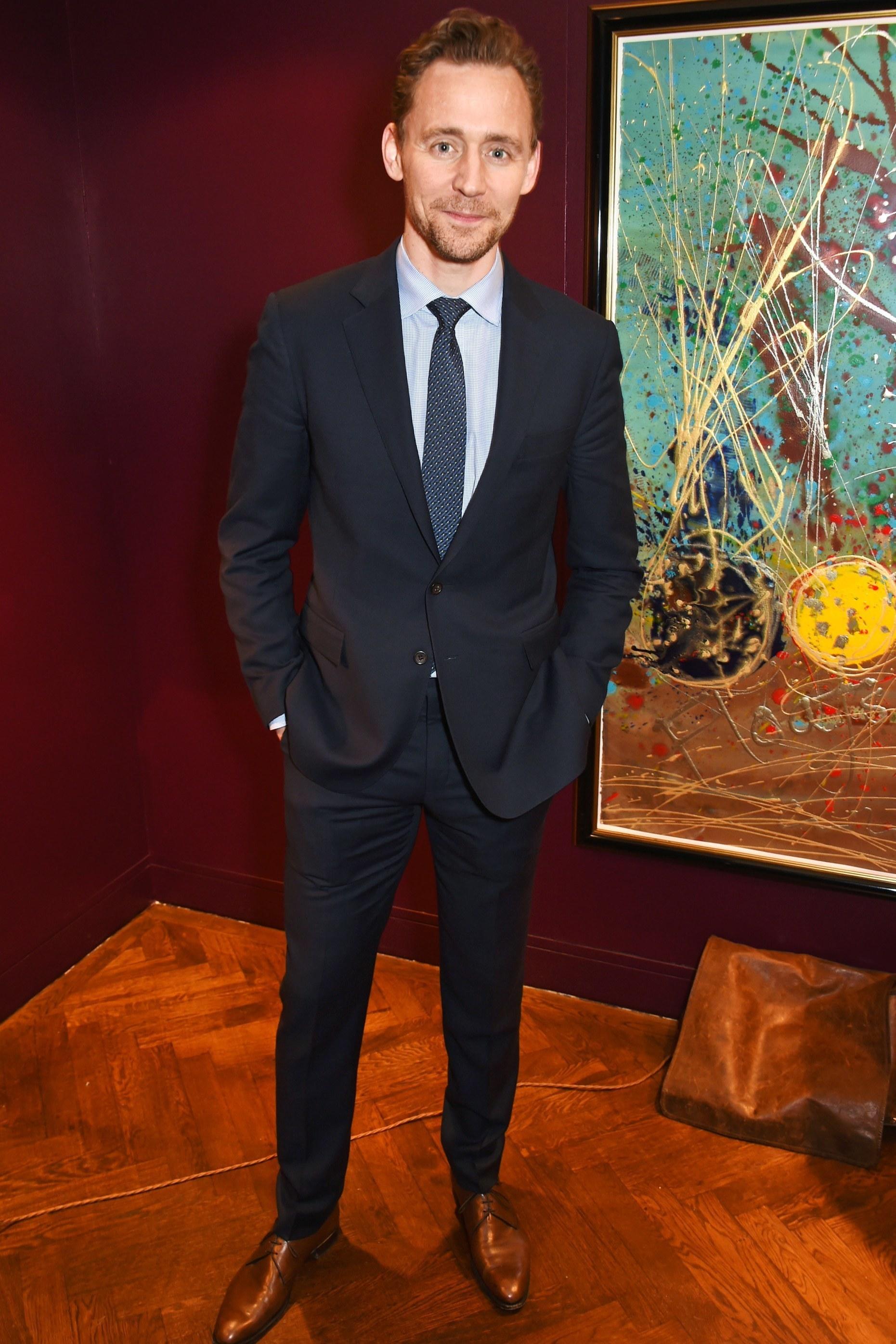 Tom Hiddleston wearing Black Suit, Light Blue Vertical Striped ...