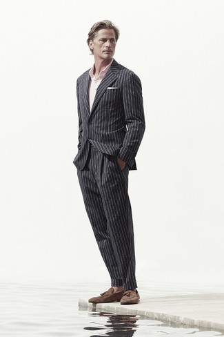 Black Vertical Striped Suit Outfits: A black vertical striped suit and a pink polo combined together are a perfect match. Don't know how to complete your look? Wear brown suede tassel loafers to rev up the classy factor.