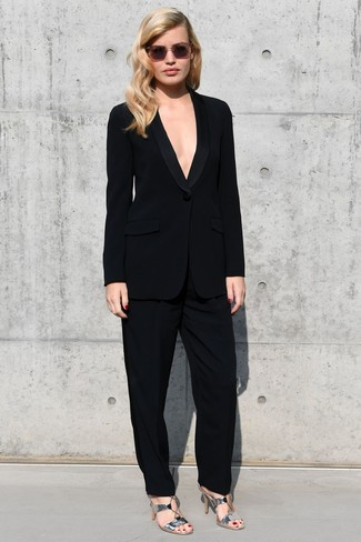 How to Wear Silver Leather Heeled Sandals: Rock a black suit to be the definition of polish. Finishing off with silver leather heeled sandals is a fail-safe way to inject an easy-going vibe into your outfit.