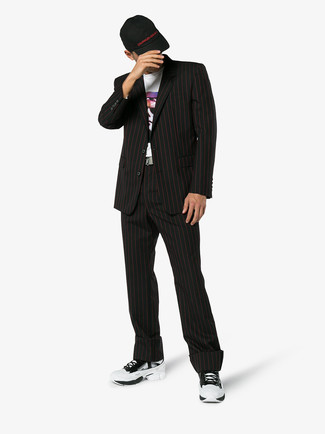 How to wear: black vertical striped suit, white print crew-neck t-shirt, white athletic shoes, black baseball cap
