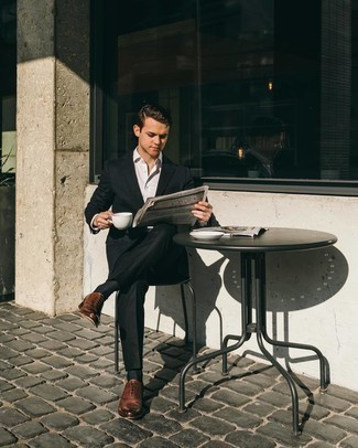Brown Leather Oxford Shoes with Black Suit Outfits: For a look that's sharp and envy-worthy, pair a black suit with a white dress shirt. Complement your ensemble with a pair of brown leather oxford shoes for maximum effect.