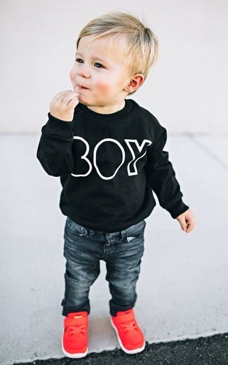 How to Wear Black Jeans For Boys: Suggest that your little one wear a black sweater and black jeans for a fun day in the park. As far as footwear is concerned, let your little guy go for a pair of red sneakers.