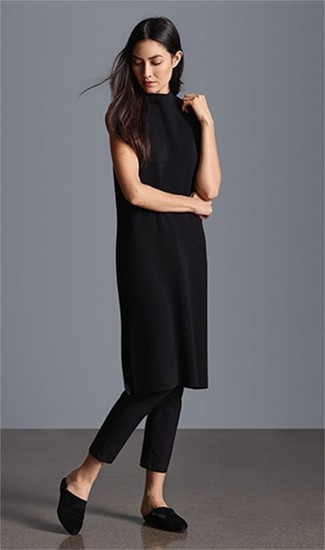 How to Wear Black Skinny Pants: Why not rock a black sweater dress with black skinny pants? These two pieces are super comfortable and will look cool when married together. And if you want to immediately kick up your ensemble with shoes, introduce black satin mules to the equation.