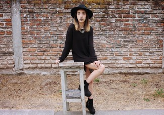 If it's comfort and functionality that you're searching for in an outfit, wear a black sweater dress. When it comes to shoes, this look is round off wonderfully with black suede wedge ankle boots.