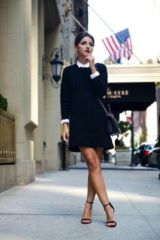 Dress to impress in a sweater dress and a white button-up shirt. Complement this look with black suede heeled sandals.