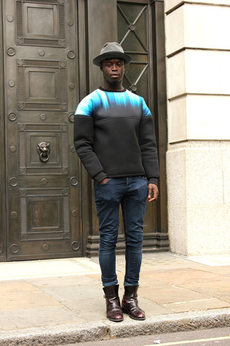 How to wear: black print sweatshirt, navy skinny jeans, burgundy leather chelsea boots, grey wool hat
