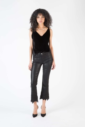 This combo of a black velvet tank and black leather flare jeans is the perfect balance between fun and flirty. Wearing a pair of black suede pumps is a simple way to add extra flair to your outfit. You know when it's super hot outside, sometimes only a fresh outfit like this one can get you through the day.