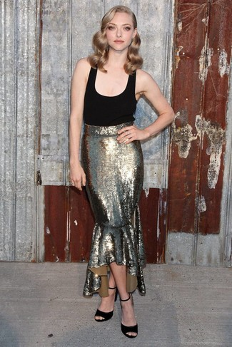 This pairing of a black tank and a gold sequin maxi skirt gives off a very casual and approachable vibe. Grab a pair of black suede heeled sandals to va-va-voom your outfit. As warmer days set in, it's time for summery getups like this one.