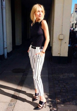 To create an outfit for lunch with friends at the weekend dress in a black tank and white and black vertical striped slim pants. Go for a pair of black leather mules to instantly up the chic factor of any outfit.
