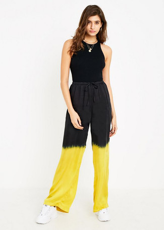 How to wear: black tank, yellow tie-dye wide leg pants, white athletic shoes, gold pendant