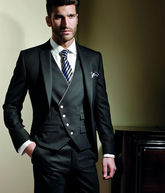 How to wear: black three piece suit, white dress shirt, black and white vertical striped silk tie, white and black vertical striped pocket square
