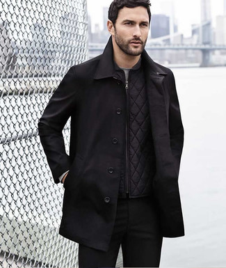 How to wear: black trenchcoat, black quilted gilet, grey long sleeve t-shirt, black chinos