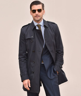 How to wear: black trenchcoat, navy suit, light blue vertical striped dress shirt, olive knit tie