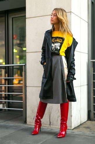 How to wear: black leather trenchcoat, yellow print crew-neck t-shirt, charcoal vertical striped full skirt, red leather over the knee boots