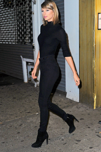 Taylor Swift wearing Black Turtleneck, Black Skinny Jeans, Black Suede Ankle Boots