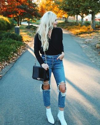 How to wear: black v-neck sweater, blue ripped boyfriend jeans, white leather ankle boots, black quilted leather satchel bag