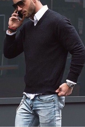 A black v-neck sweater and light blue jeans is a versatile combination that will provide you with variety.