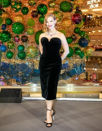 Marry a black velvet sheath dress with a silver necklace if you're going for a neat, stylish look. For shoes, go for a pair of black satin heeled sandals. If you're on the hunt for a summer-friendly look, here is a great one.