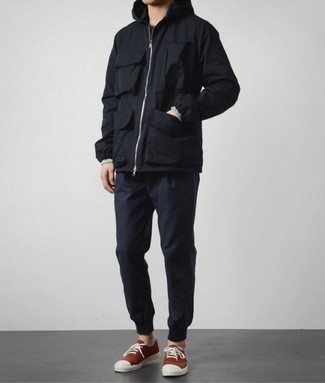 How to Wear Navy Sweatpants For Men: For a relaxed casual getup, wear a black windbreaker with navy sweatpants — these two pieces work nicely together. When it comes to shoes, this getup is complemented well with red canvas low top sneakers.