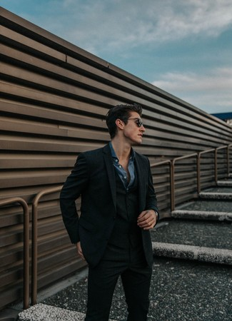 How to wear: black check wool three piece suit, navy chambray long sleeve shirt, black sunglasses