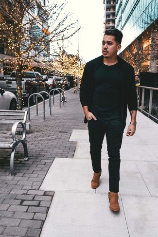 How to wear: black zip sweater, black crew-neck t-shirt, black jeans, brown suede cowboy boots