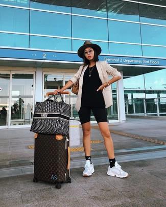 How to wear: beige blazer, black bike shorts, white athletic shoes, tan plaid canvas tote bag