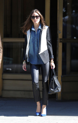 A monochrome blazer with black leather slim jeans has become an essential combination for many style-conscious girls. Blue suede pumps will add elegance to an otherwise simple look.