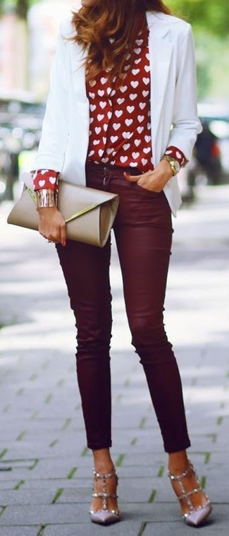 Marry a white blazer jacket with oxblood slim jeans to create a chic, glamorous look. Grey studded leather pumps will add a touch of polish to an otherwise low-key look.