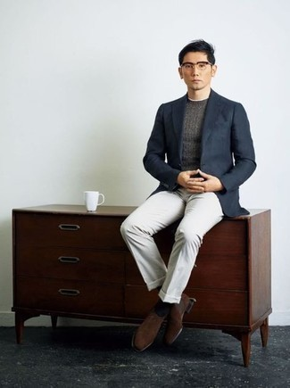 White Dress Pants Outfits For Men: A navy blazer and white dress pants are absolute wardrobe heroes if you're putting together an elegant wardrobe that matches up to the highest sartorial standards. Why not introduce dark brown suede chelsea boots to the equation for a hint of stylish casualness?