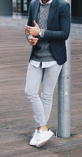 If you feel more confident in comfy clothes, you'll love this seriously stylish pairing of a Gucci men's Navy Textured Wool Two Button Blazer and grey skinny jeans. Finish off this getup with white leather low top sneakers. These picks will keep you comfortable and stylish in summer-to-fall weather.