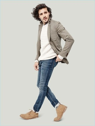 Grey Blazer with Blue Jeans Outfits For Men: Try teaming a grey blazer with blue jeans for a neat refined menswear style. Let your styling savvy truly shine by finishing this ensemble with tan suede desert boots.