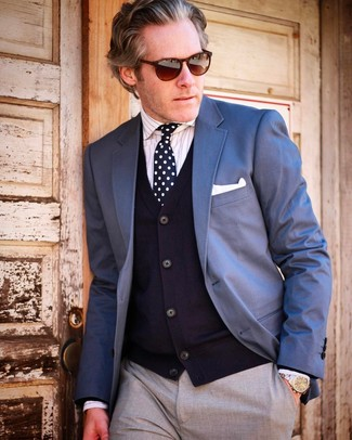 Blue Blazer with Grey Pants Outfits For Men After 50: A blue blazer looks so polished when matched with grey pants in a modern man's outfit. This pairing demonstrates that even after fifty your styling options are still far from limited.