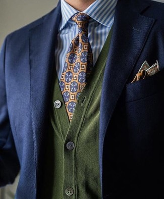 How to wear: navy blazer, olive cardigan, white and blue vertical striped dress shirt, orange print tie