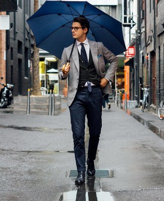 How to wear: grey blazer, black cardigan, white dress shirt, navy chinos