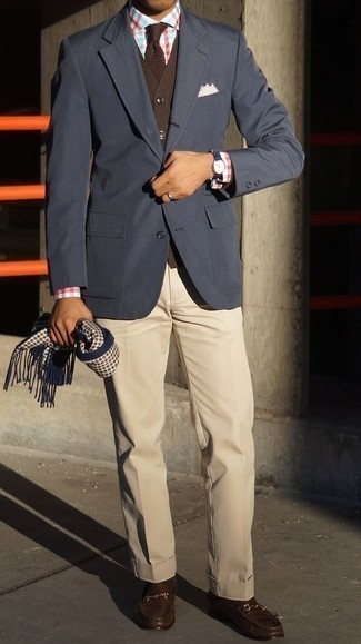 Dark Brown Cardigan Outfits For Men: Putting together a dark brown cardigan and beige dress pants is a surefire way to infuse manly refinement into your wardrobe. Complement this look with a pair of dark brown leather loafers and ta-da: your getup is complete.